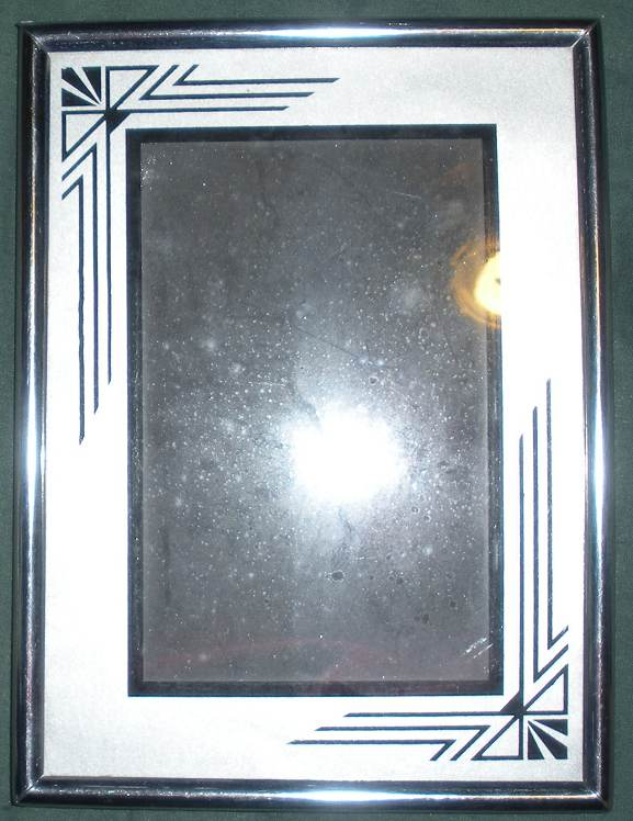 1920s 30s art deco silver and black reverse painted frame 6 x 8 with a 3 12 x 5 14 picture opening space in the back of the frame to put